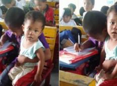 Ubogi filipinski deček odločen, da naredi šolo. S seboj prinese bratca...